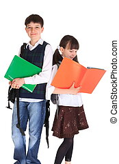 Cute siblings going to a school holding their notes, isolated on white studio background.