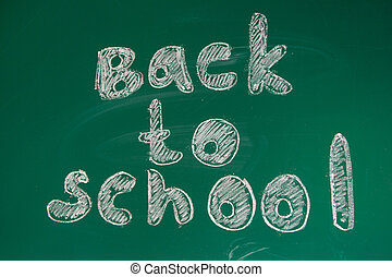 School green board with the word BACK TO SCHOOL.