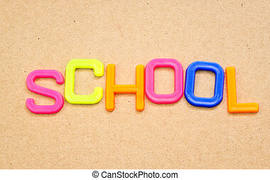 School in colorful toy letters on paper background