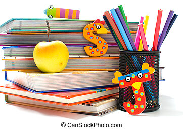 Stack of books with funny letters and a healthy snack