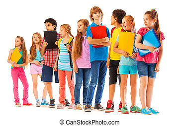 School kids standing in the line with books
