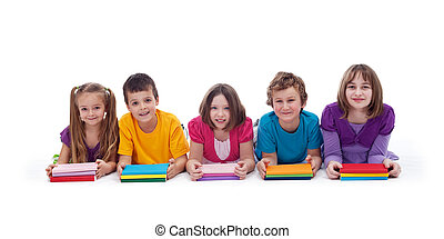 School kids with colorful books smiling in a row - isolated
