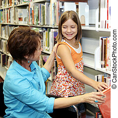 School Library - Choosing Book - A librarian helps a child...