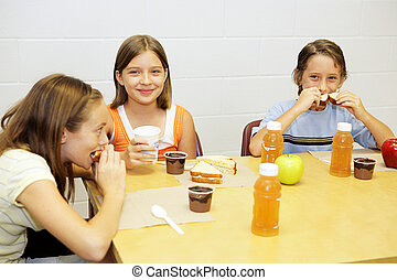 School Lunch in Cafeteria - A group of school children...