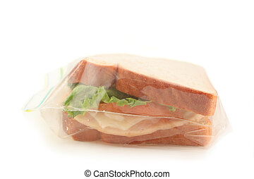 school lunch - isolated whole wheat sandwich in clear...