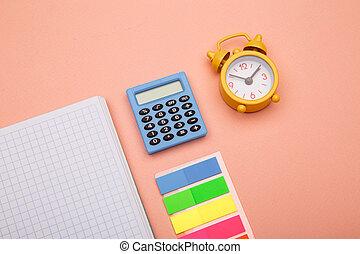 School office supplies on pink background