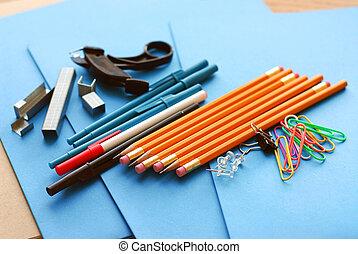 School or office supplies on blue paper folders