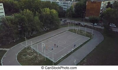 School sports ground - Kids play basketball on school sports...