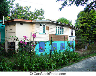 typical school architecture style bequia st. vincent and the grenadines in the caribbean with tropical plants
