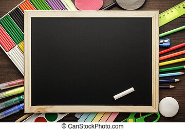 school supplies and blackboard with copy space on the table