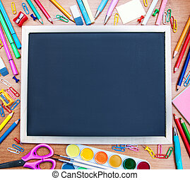 school supplies and blackboard