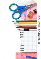 school supplies and checked notebook isolated on white...