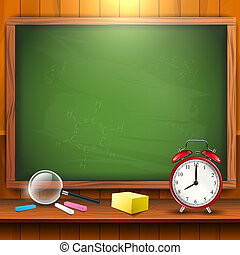 School supplies and empty blackboard