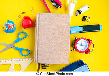 School supplies and mockup daybook on yellow background, top view. Back to school concept