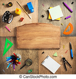 school supplies at wooden background