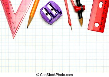 School supplies border over graphing paper background