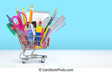 school supplies in shopping cart -