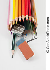 School supplies on a white background outgoing of colored pencils tube
