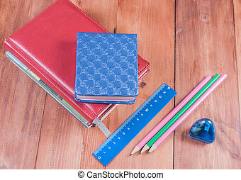 School supplies on a wooden background. Back to school.
