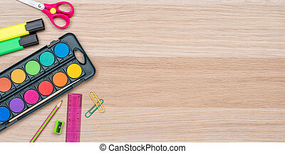 School supplies on a wooden background with copy space