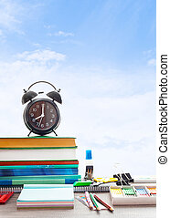 School Supplies on background blue sky with clouds