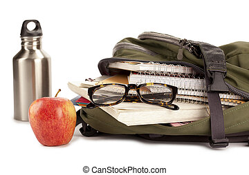 school supplies on backpack with apple beside