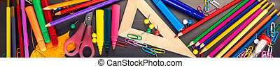 School supplies on black board background with Stationery....