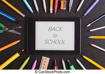 School supplies on blackboard