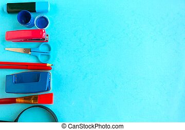 School supplies on blue background, top view. Back to school concept. Copy space for the text