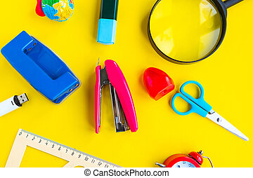 School supplies on bright yellow background, top view. Back to school concept