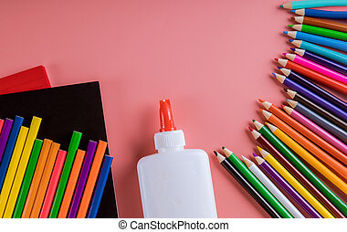School supplies on pink background, back to school