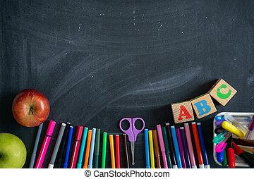 School supplies on the background of blackboard. Back to school