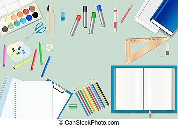 School supplies on the green background