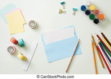 School supplies on white table. Back to school concept