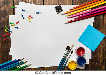 School supplies with blank on wooden background. Copyspace
