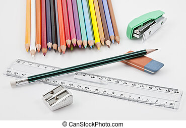 School supplies with colored pencils, pencil,  eraser, sharpener, stapler and plastic ruler