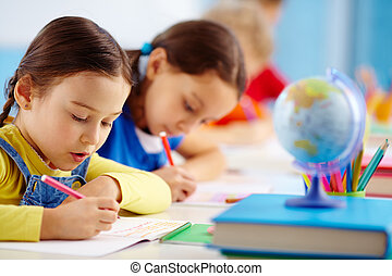 School test - Pupils sitting in a row writing a test