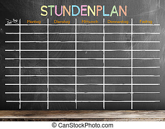 school timetable or class schedule with word STUNDENPLAN, German for schedule, template on chalkboard