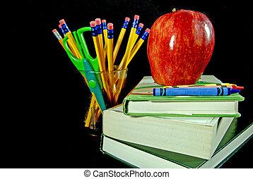 School Tools - Apple on school books.