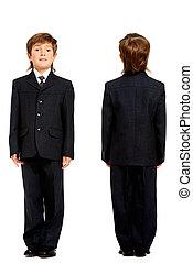school uniform - Full length portrait of a boy in a suit,...