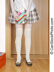 School uniform plaid skirt - Female pupil wearing school...
