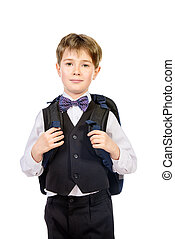 school uniform - Portrait of a boy in a suit standing with...