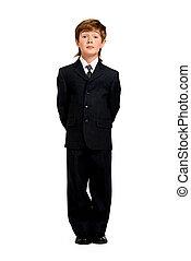 school uniform - Full length portrait of a boy in a formal...