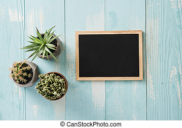 School vintage blackboard with chalk on a wooden desk, back to school concept
