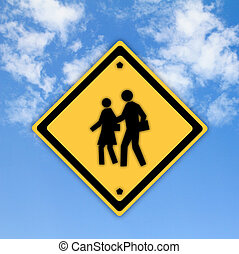 School warning sign on yellow with a blue sky background