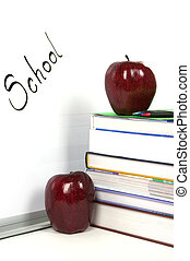 School - White board, apples and books in a classroom
