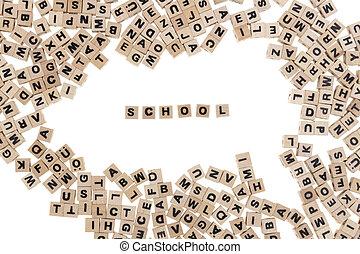 school written in small wooden cubes school framed by