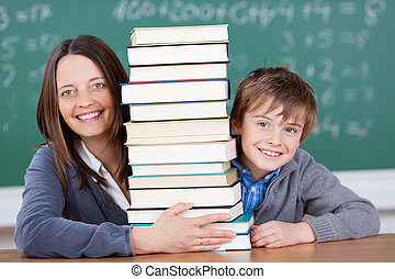 Schoolbooks - Happy teacher and student with a pile of books...