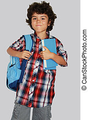 Schoolboy - A beautiful schoolboy with blue bag, isolated on...