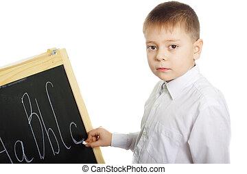 Schoolboy at blackboard